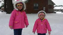 Alyssa Glover and Riley Glover playing in the snow. Wilson, NC