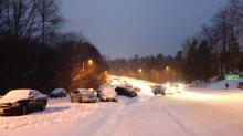 IMAGES: Communities finish towing cars left behind in snowstorm