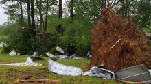 IMAGES: Cleanup begins after strong storms damage homes, down trees