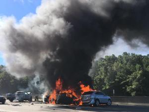Cars on fire closed westbound lanes of Interstate 40 in Durham Monday morning.