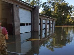 "On 10/8 just after 2300 a flash flood entered Cotton Volunteer Fire Department just outside of Hope Mills. The firefighters had just returned from one of dozens of water rescues that day to quickly drive all of the fire apparatus away from the station. The crews spent the rest of the night at Gray's Creek Station 24 and today setup temporary operations on Missy Bird Lane. Tomorrow they will move to a vacant building in the district. They are still continuing to run fire and water rescue calls despite their own home being destroyed by flood. They need to be recognized as examples for the rest of the community in the Gray's Creek area and Cumberland County. You can find pictures of the destruction on our Facebook page ""Cotton Volunteer Fire Department Station 4"". Cotton VFD has been around for over 50 years and is led by Fire Chief Owen Harris."