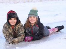 While some areas saw more sleet than snow, young people and animals got out to enjoy the winter weather.