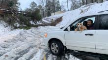 IMAGES: First snow of the season fun for some, dangerous to drivers