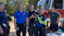 IMAGES: Heroes: Fire fighters rescue 3 baby squirrels from roof of burning house