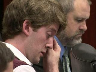 Jason Williford wipes tears from his eyes as his mother testifies during his capital murder trial on May 23, 2012. He is accused of first-degree murder in the March 9, 2010, death of state school board member Kathy Taft.