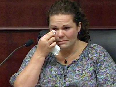 Meredith Fisher testifies June 8, 2011, in the first-degree murder trial of her former brother-in-law, Jason Young, who is accused of killing his wife, Michelle Young, in November 2006.