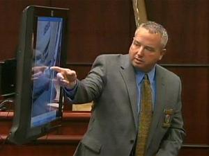 Mike Galloway, an investigator with the City-County Bureau of Identification, shows jurors photos of Jason Young's Ford Explorer during his testimony on June 13, 2011.