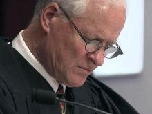 Judge threatens to charge juror for discussing case