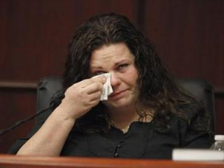 Meredith Fisher, sister of Michelle Young, tears up as she describes her sister's relationship with Jason Young during his retrial on Feb. 7, 2012. (Photo by Shawn Rocco, The News & Observer, Pool)
