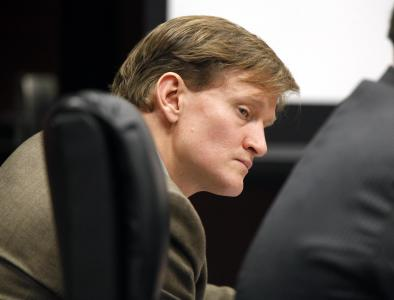 Jason Young listens as Meredith Fisher, sister of Michelle Young, describes Michelle's relationship with him during his retrial on Feb. 7, 2012.  (Photo by Shawn Rocco, The News & Observer, Pool)