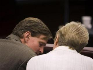 Jason Young speaks with mother Pat Young during a recess in his retrial on Feb. 7, 2012. (Photo by Shawn Rocco, The News & Observer, Pool)