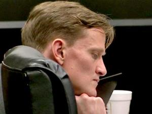 Jason Young listens to testimony in his first-degree murder trial on Feb. 20, 2012.