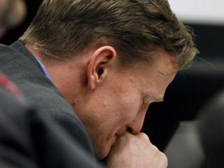 Jason Young cries as his mother, Pat Young, testifies during his murder trial on Feb. 27, 2012. (Photo by Takaaki Iwabu, The News & Observer, Pool)
