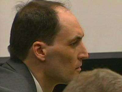 Brad Cooper, on trial for first-degree murder in the July 12, 2008, death of his wife, Nancy Cooper, listens to a 911 call played in court March 15, 2011.