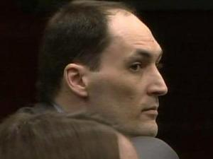 Brad Cooper, on trial for first-degree murder, listens March 21, 2011, as a crime scene investigator describes the site where Nancy Cooper was found July 14, 2008.