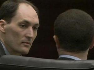 Brad Cooper talks with his defense attorney, Howard Kurtz, during testimony on March 22, 2011.