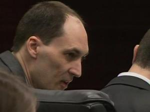 Brad Cooper talks to his defense attorney, Howard Kurtz, during his first-degree murder trial on March 31, 2011.