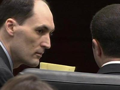 Brad Cooper, on trial for killing his wife, Nancy Cooper, talks to his defense attorney, Howard Kurtz, on April 8, 2011.
