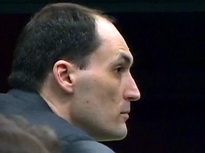 Brad Cooper sits during his first-degree murder trial on April 15, 2011.