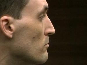 Brad Cooper listens during closing arguments of his first-degree murder trial on May 3, 2011.