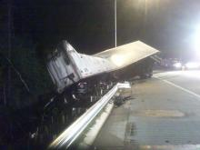 A car and a tractor-trailer carrying cases of beer sideswiped each other on the eastbound Interstate 540 exit ramp.