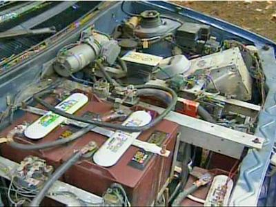 Underneath the hood of this converted 1989 Geo Metro lies an electrical outlet and 14 Club Car batteries.