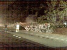 Refuse from an overturned garbage truck caught fire on Interstate 40, near Wade Avenue, causing authorities to shut down both sides of the highway, shortly before 7 p.m. Monday, Jan. 26, 2009.