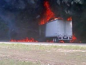 A tractor-trailer was fully engulfed in flames Monday on I-40 at Gorman Street.