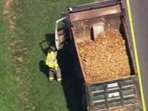 Sky 5 flies over dump truck wreck on Highway 64 in Apex.