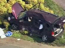 Sky 5 flies over a dump truck and van wreck on Highway 64 in Apex.