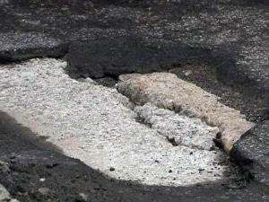 "The pavement on Glenwood Avenue is ""spalling,"" meaning the asphalt is coming loose from its concrete base, according to DOT engineers."