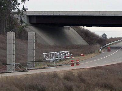 Columns erected along N.C. Highway 540 will support a cashless toll system.