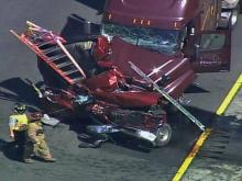 All lanes of Interstate 40 West closed at U.S. Highway 15/501 in Durham County after a wreck involving at least two cars and a tractor-trailer on June 30, 2011.