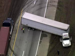 A jackknifed tractor-trailer closed eastbound Interstate 40 near N.C. Highway 86 in Orange County on Feb. 6, 2012.