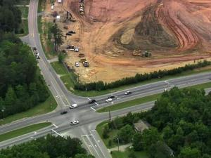 Holly Springs is planning for two major traffic additions -- a shopping center and a link to Interstate 540.
