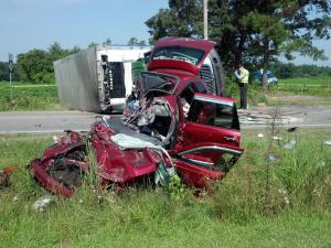 Troopers respond to a crash at the intersection of N.C. Highway 55 and N.C. Highway 242 in Dunn on Thursday morning, July 26, 2012.