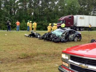 A car hit two tractor trailers Monday on U.S. Highway 264 in Nash County.