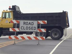 A DOT truck blocks the entrance to Bonner Bridge on Dec. 4, 2013, one day after state officials closed the Outer Banks span, saying it was in danger of collapsing.