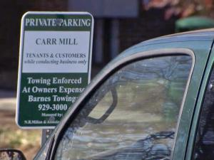 Carrboro is considering an increase both to parking signs and the fee for disobeying them.