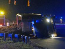 A tractor-trailer carrying mulch overturned early Wednesday while trying to access Interstate 40 East at Hammond Road in Raleigh, police said.