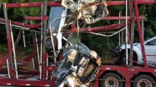 IMAGES: Tractor-trailer carrying cars hits train trestle in Apex