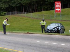State Highway Patrol troopers investigate a Sept. 29, 2014, crash involving three cars on northbound Capital Boulevard at Caveness Farms Avenue in Wake Forest.
