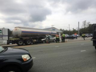 A car crashed into a fuel truck near the intersection of Apex Peakway and Ten Ten Road shortly before noon Wednesday, Oct. 1, 2014. (Photo courtesy of Michael Carter)