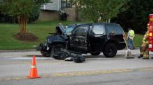 IMAGES: SUV hits Wake County school bus in northeast Raleigh