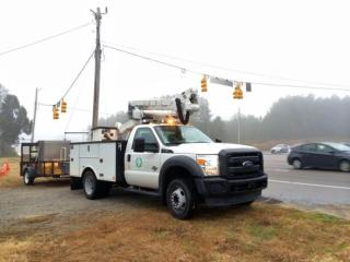 Crews from the Town of Cary were installing a new traffic signal Wednesday morning at the intersection of N.C. Highway 55 and McCrimmon Parkway, hoping to improve safety near where a Panther Creek High School student was killed in September. (Photo by Leyla Santiago)