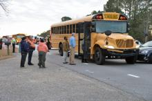 A school bus carrying students to Smithfield Middle School was involved in a wreck early Friday on U.S. Highway 70 business, North Carolina State Highway Patrol officials said.