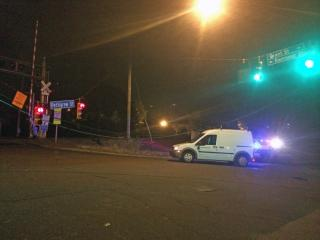 Durham police closed a busy intersection early Friday after a car crashed into a poll supporting traffic lights.