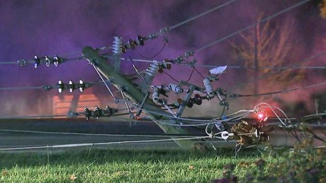 Authorities shut down all lanes of U.S. Highway 401 at Mechanical Boulevard in Garner early Thursday after a vehicle hit a power pole and sent power lines into the road.