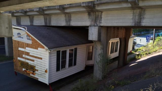 A prefab home got stuck Monday afternoon under a Chapel Hill bridge, briefly bringing traffic to a standstill.