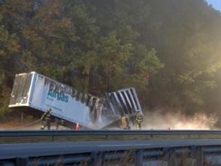 No injuries were reported Tuesday morning when a tractor-trailer carrying dry ice caught fire on the shoulder of Interstate 95 South in Johnston County.